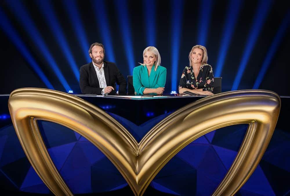 Jens Dendoncker, Julie Van den Steen en Karen Damen gaan raden welke bekende Vlamingen er onder het kostuum en masker zitten bij The Masked Singer - vanaf 18 september 2020 bij VTM.